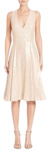 Alice + Olivia short dress Beige Mindee Gold Sleeveless V Neck Textured Midi Tea 0 on Tradesy