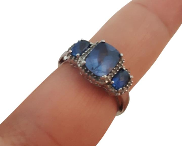 Blue Sapphire created ring in 10K white gold.