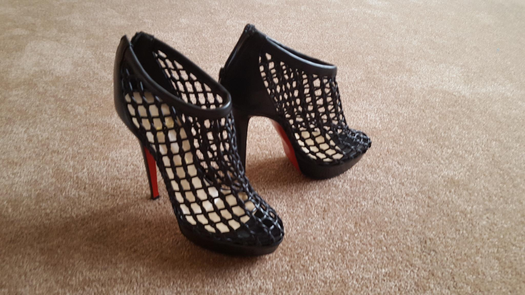 new product 2dad4 bb2fe where to buy christian louboutin coussin caged ankle boots ...