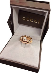 Gucci gucci 18 k gold adjust size ring