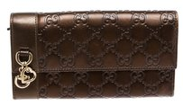 Gucci Gucci Bronze Leather Monogram Charm Guccissima Wallet