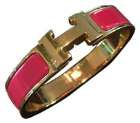 Hermès Clic H Enamel Bracelet in Amarath Red and Gold