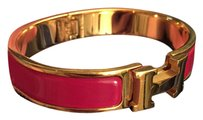 Hermès Clic H Enamel Bracelet in Red and Gold