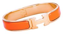 Hermès Hermes Orange Clic H Gold GHW Narrow Enamel Bracelet PM Iconic!