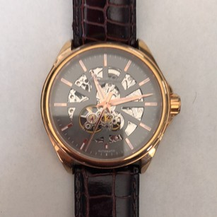 Kenneth Cole exhibition dial and caseback rose gold