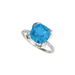 LoveBrightJewelry Blue Topaz and CZ Engagement Ring in 14K White Gold
