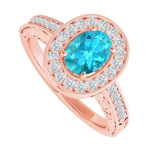LoveBrightJewelry Blue Topaz and CZ Halo Ring in 14K Rose Gold Vermeil