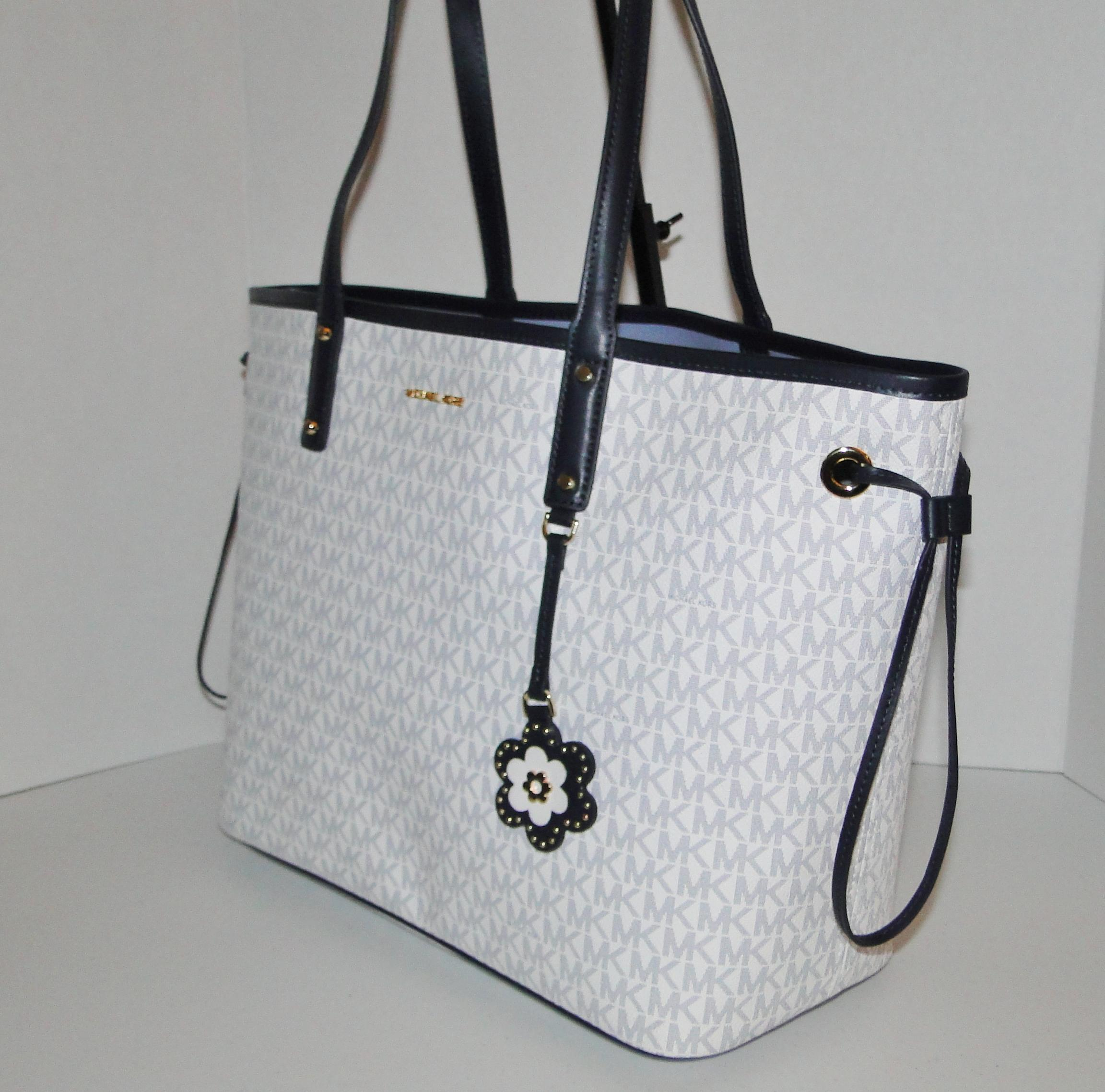 d8678698e692 ... top quality the best attitude 1d321 fa6fe michael kors carter large  signature reversible tote in white