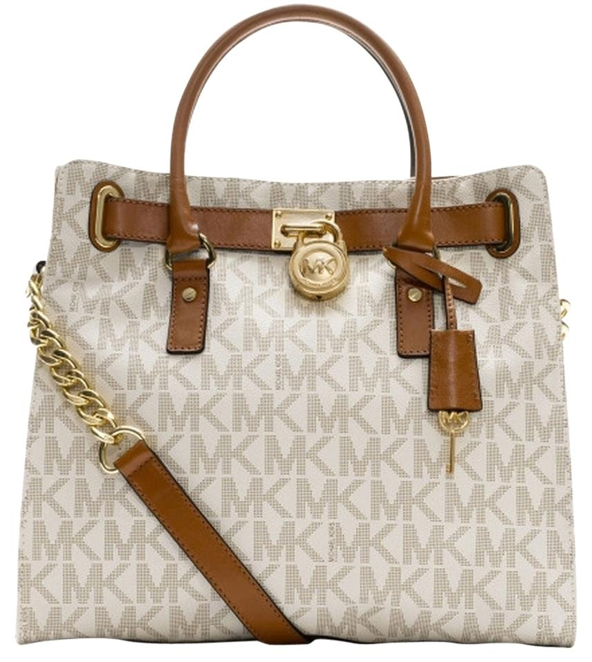 af6d59124ff0 ... fob keychain hanging purse charm b1cd5 9df49  cheapest michael kors  monogram lock and key tote in vanilla signature gold tone hardware f9db2  6e185