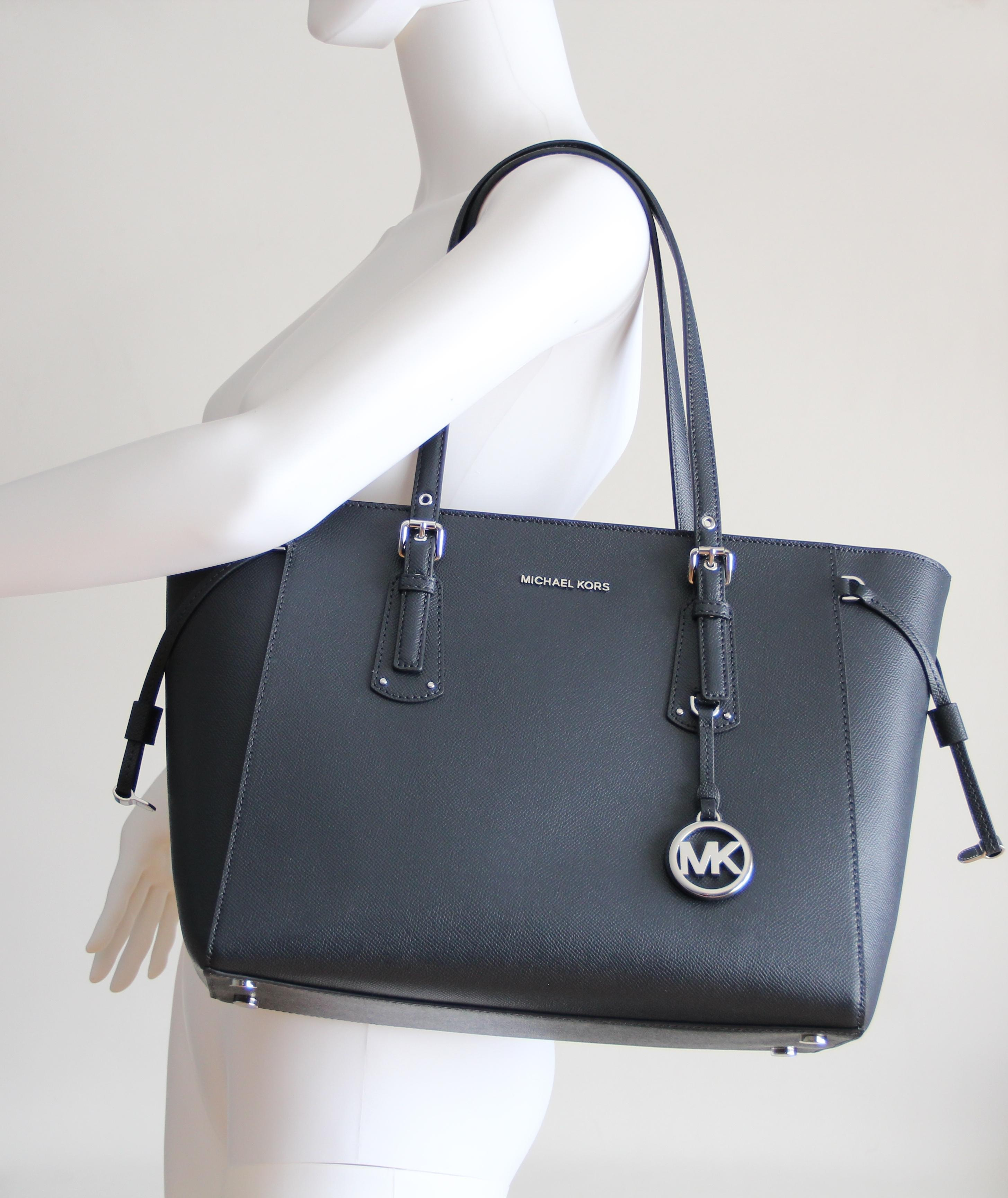 0fd710c0c40e ... coupon code michael kors multifunction leather voyager tote in blue.  123456789101112 425c5 e0032