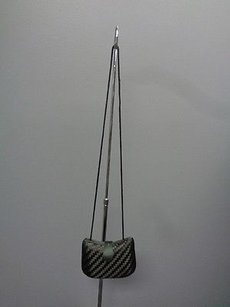 A Delill Creation Rope Black Clutch