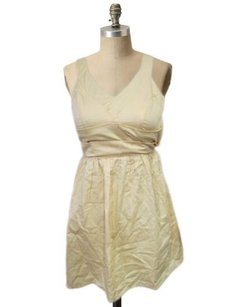 Pins and Needles short dress Gold Black Urban Outfitters on Tradesy