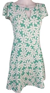 Poema short dress black and white Green Floral on Tradesy