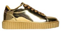 Nike Sneakers Puma gold metallic Flats