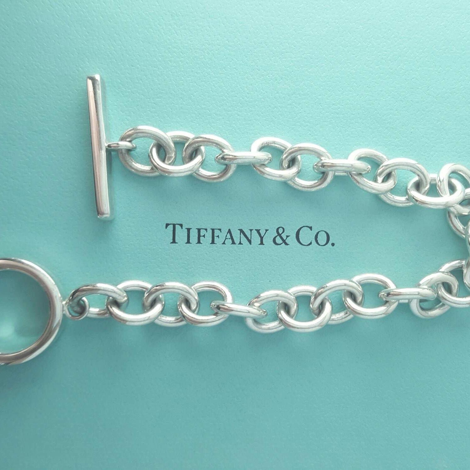 tiffany co 1837 collection silver Tiffany & co victoria collection platinum tanzanite & diamond pendant   tiffany & co sterling silver 1837 collection square cushion bangle bracelet.