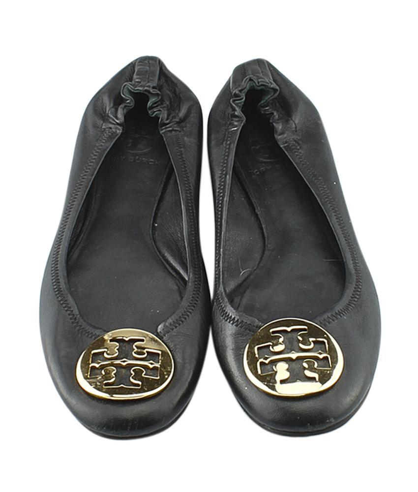 - The Tory Burch designer ballet flats are made of genuine leather. The shoes measure 26cm in length through the inside middle of the shoe & cm in length along the bottom of the sole. *Please note the size is not visible on the shoes due to scratches/ wear so I'm estimating they would fit a size 40 woman.